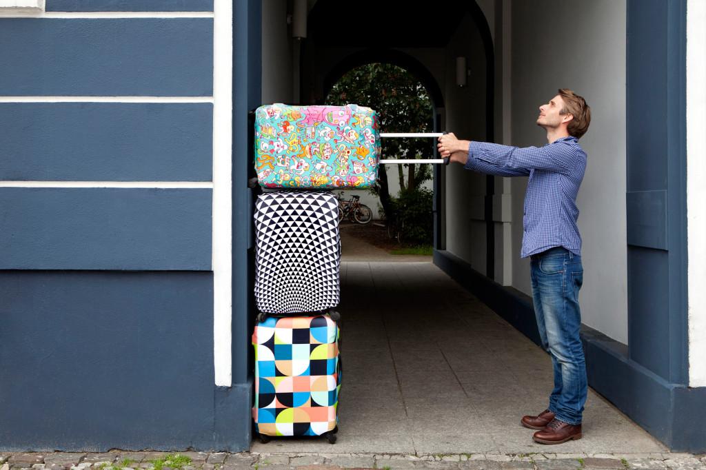 kolorowe pokrowce na walizki loqi